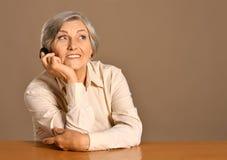 elderly woman speaking Stock Photo