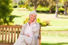 Elderly woman speaking on the phone stock photos