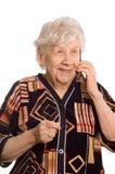 Elderly woman speaks on the phone. The elderly woman speaks on the phone royalty free stock photos
