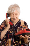 Elderly woman speaks on the phone Stock Photography