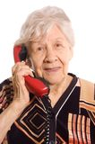 Elderly woman speaks on the phone Stock Images
