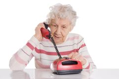 Elderly woman speaks on the phone royalty free stock photo
