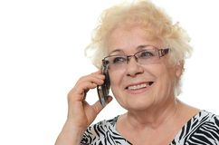 The elderly woman speaks on phone Royalty Free Stock Photography
