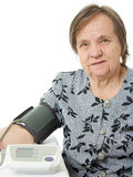 An elderly woman with a sphygmomanometer Royalty Free Stock Photo