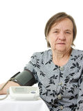 An elderly woman with a sphygmomanometer Stock Photography