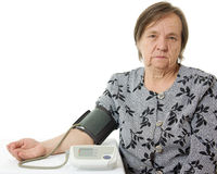 An elderly woman with a sphygmomanometer Stock Image