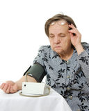 An elderly woman with a sphygmomanometer Royalty Free Stock Image