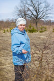 Elderly woman in a spring forest Stock Photo