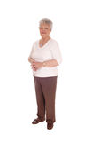 Elderly woman standing for white background. Royalty Free Stock Image