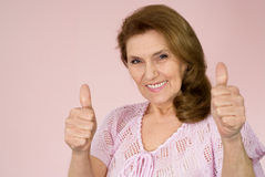 Elderly woman stands Royalty Free Stock Photo