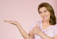 Elderly woman stands Royalty Free Stock Image