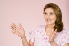 Elderly woman stands Royalty Free Stock Images