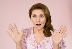 Elderly woman stands Stock Photo