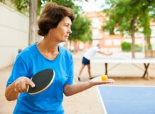 Elderly woman starts a party in table tennis. Elderly women starts a party in table tennis at outdoor royalty free stock images