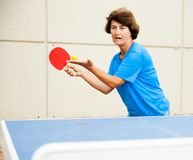 Elderly woman starts a party in table tennis. At outdoor stock images