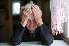An elderly woman in a state of depression. Pensioner. Stock Images