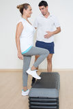 Elderly woman step exercise. Physical therapist showing step exercise to senior woman Stock Photo