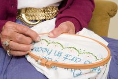 Elderly woman stitching Royalty Free Stock Photos