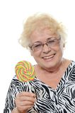 The elderly woman with sugar candy Stock Photography