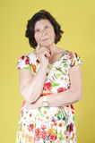 Elderly woman in a summer dress. Royalty Free Stock Photography