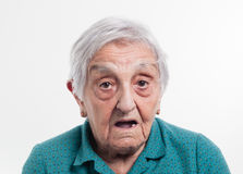 Elderly woman with surprised expression Royalty Free Stock Photography