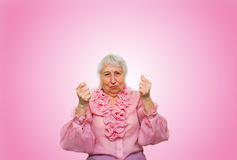 Elderly woman in suspense and determination Stock Images