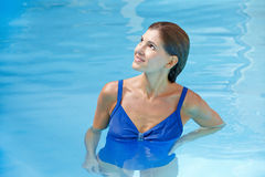 Elderly woman in swimming pool stock images