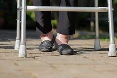 Elderly woman swollen feet using walker Royalty Free Stock Photo
