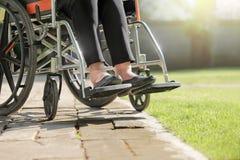 Elderly woman swollen feet on wheelchair Royalty Free Stock Images