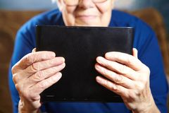 Elderly woman with tablet computer Stock Images