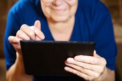 Elderly woman with tablet computer Stock Photos