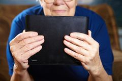 Elderly woman with tablet computer Royalty Free Stock Photo