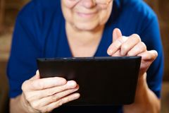 Elderly woman with tablet computer Stock Photography