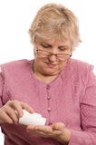 The elderly woman with tablets Royalty Free Stock Photography