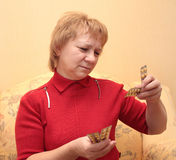Elderly woman with tablets Royalty Free Stock Photos