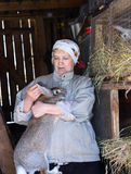Woman takes care of the rabbits on the farm Royalty Free Stock Photo