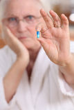 Elderly woman taking medication Royalty Free Stock Photos