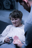 Elderly woman taking medicines Royalty Free Stock Photography