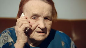 Elderly woman talking on the cell phone Stock Photo