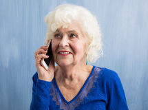 Elderly woman talking on mobile phone Stock Photography