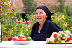 Elderly woman talking at the table Stock Photo