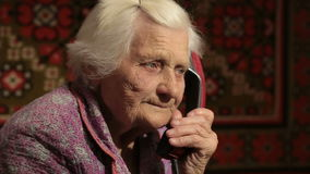 The Elderly Woman talking on the telephone With Rotary Dial Close Up stock video