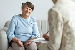 Elderly woman talking to a financial advisor about a loan stock image
