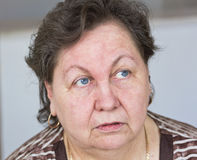 An elderly woman talking to someone.A close-up portrait Stock Image