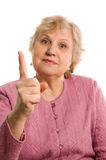 The elderly woman threatens with a finger Stock Photography
