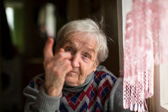 Elderly woman threatens with a finger Stock Photography