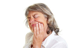 Elderly woman with toothache royalty free stock photography