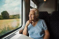 Elderly Woman in the train stock photography
