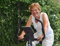 Elderly woman training Stock Image