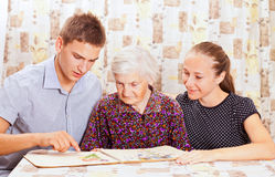 Elderly woman with the two grandchild Royalty Free Stock Photography
